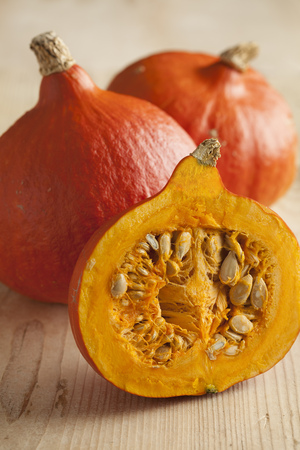 pumpkin seed: Fresh ripe orange whole and half hokkaido pumpkin