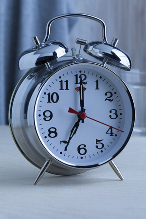 seven o'clock: Traditional alarm clock at seven oclock in the morning
