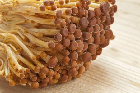 heap up: Heap of fresh golden Enoki mushrooms close up Stock Photo