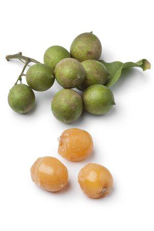 Fresh quenepa fruit on white background