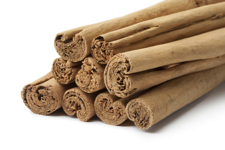 cinnamomum: True cinnamon sticks close up on white background