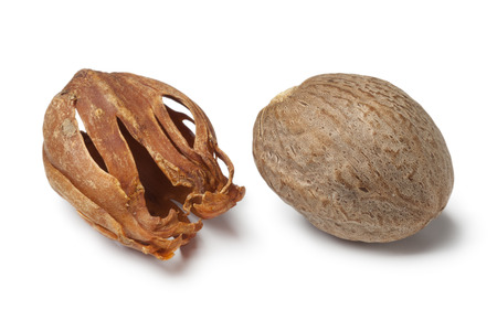 mace: Single nutmeg kernel and mace on white background Stock Photo
