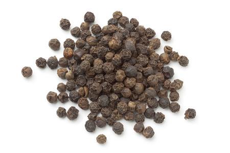 heap: Heap of black peppercorns on white background