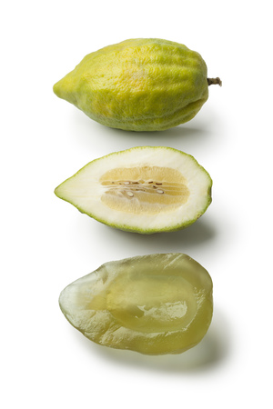 etrog: Fresh green whole and half Citrus medica and succade on white background Stock Photo