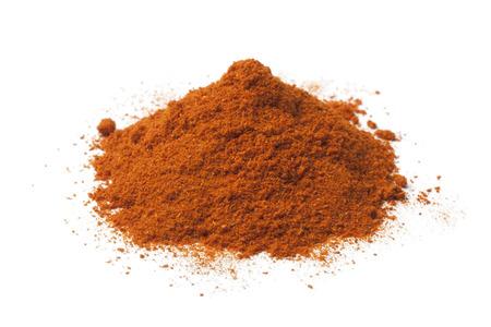 Heap of ground chili powder on white background Stock Photo