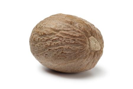 kernel: Single nutmeg kernel on white background