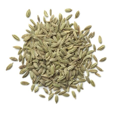 fennel seeds: Heap of green fennel seeds on white background
