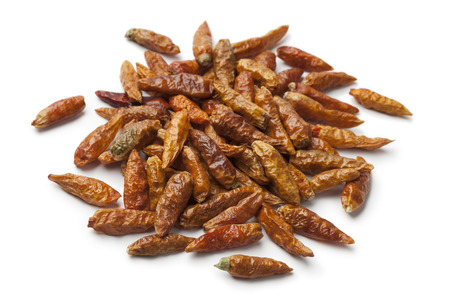 outs: Heap of dried chili peppers on white background Stock Photo