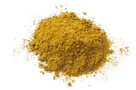 curry powder: Heap of ground curry powder on white background Stock Photo