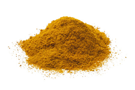 dried herbs: Heap of yellow turmeric powder on white background