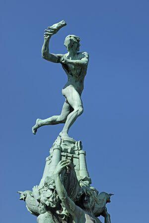 antwerp: Statue of Brabo throwing the hand of the giant Antigoon on the Grote Markt, Antwerp Belgium