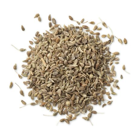 aniseed: Heap of dried anise seeds on white background