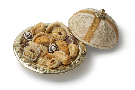 variety: Traditional Moroccan festive cookies on a metal tajine on white background Stock Photo