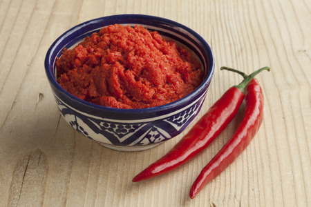 red pepper: Bowl with Moroccan red harissa and fresh red peppers