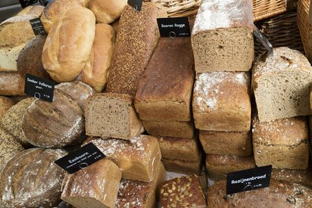 eating pastry: Variety of bread for sale on the Noordermarket in Amsterdam, Holland Stock Photo