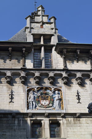 city coat of arms: Coat of arms of the city of Antwerp above the gate of the Steen castle, Belgium Editorial