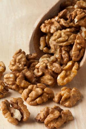 walnut: Wooden scoop with shelled walnuts