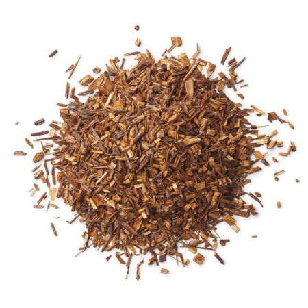 red bush tea: Heap of South African Rooibos tea on white background