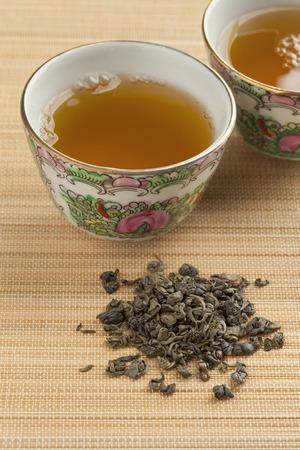 gunpowder tea: Two cups with green gunpowder tea