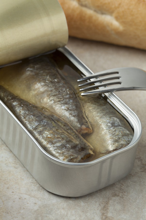 cramped: Open tin of sardines in oil