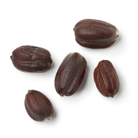 outs: Brown Jojoba seeds on white background