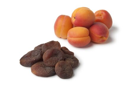 dried: Healthy fresh and sun dried apricot fruit on white background Stock Photo