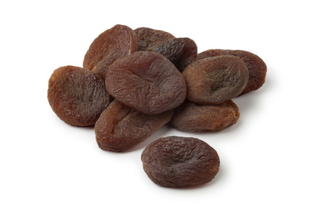 Heap of healthy nutritious sun dried apricot fruit on white background
