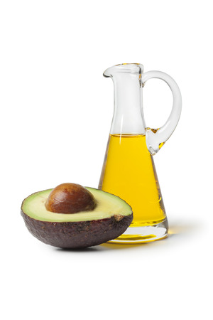 Bottle of avocado oil on white background