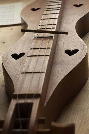appalachian: Appalachian mountain dulcimer instrument close up Stock Photo