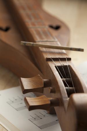 appalachian: Appalachian mountain dulcimer instrument close up Stock Photo