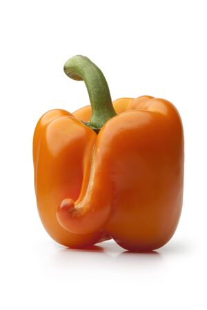 Deformed orange bell pepper on white background