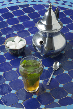 mint tea: Traditional Moroccan glass of mint tea outdoors