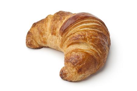 Single fresh baked croissant on white background