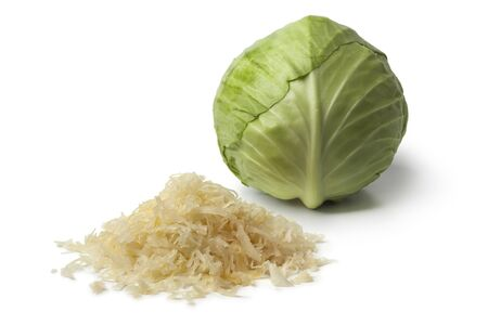 Fresh white cabbage and a heap of preserved sauerkraut on white background