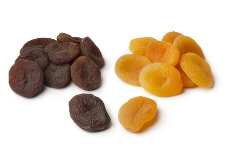 dried: Heap of healthy nutritious brown and orange dried apricot fruit on white background
