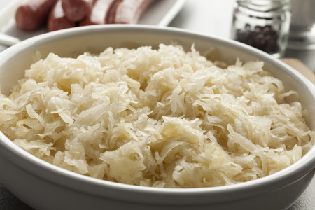 Bowl with raw preserved sauerkraut ready to cook