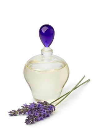 lavender oil: Bottle with lavender oil and purple flowers on white background
