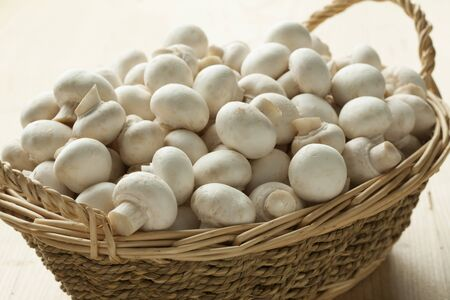 button mushrooms: Basket with small white button mushrooms