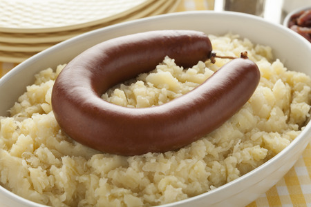 Traditional dutch meal with sauerkraut and smoked sausage