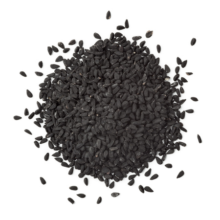 nigella seeds: Heap of black nigella seeds on white background