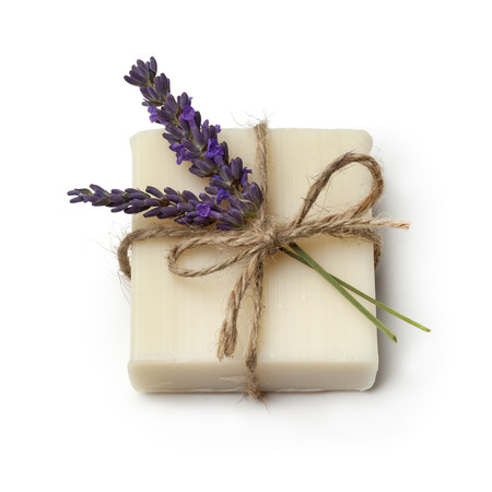 Piece of lavender soap and fresh lavender on white background