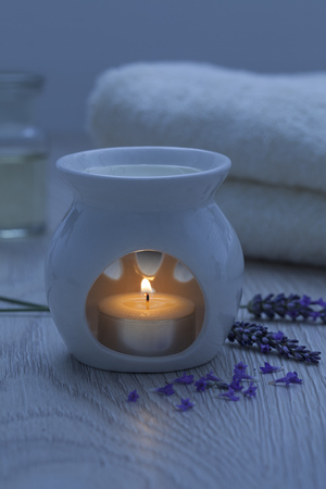 lavender oil: Candle for aroma therapy with lavender oil Stock Photo