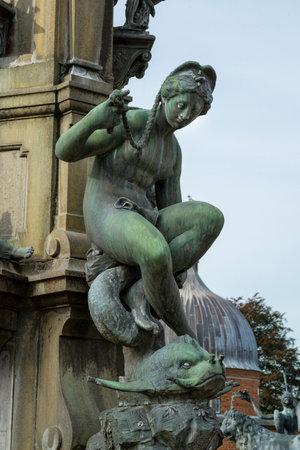 historical monument: Detail of the Neptune Fountain in Frederiksborg Castle in Hillerod, Denmark