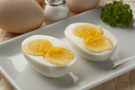 yolk: Cooked double yolk egg on a dish