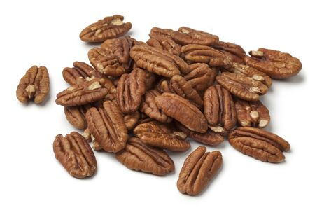 Heap of shelled pecan nuts on white background
