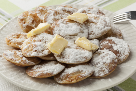 dutch: Dish Dutch mini pancakes called poffertjes with white sugar and butter