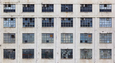old windows: Windows in a facade of an old neglected factory building