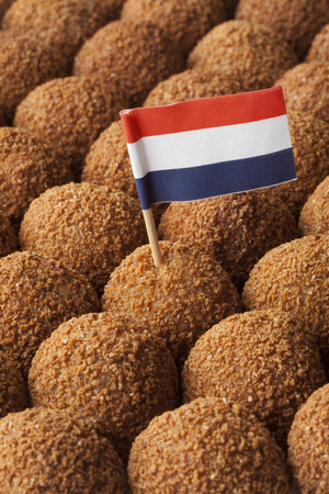 full frame: Dutch traditional snack bitterballen full frame with a dutch flag cocktail stick