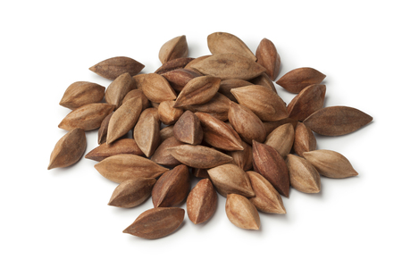 pili: Heap of unshelled pili nuts from the Philippines on white background