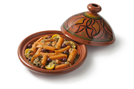 Moroccan tagine with chicken, carrots, olives and preserved lemon on white background Stock Photo